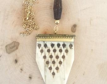 Carved oxbone necklace