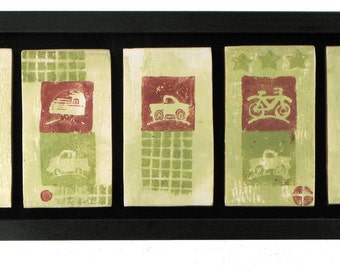 """Truck, trailer and bicycle tiles in a black wooden frame 5"""" x 13"""""""