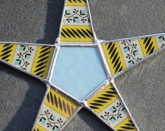 Pippa- 9.5 inch glass star with lacquered fabric on glass points with stained glass center