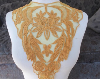 Cute embroidered applique  1 piece listing 11 1/2 inches wide at the neck 3 inch wide the the shoulders 13 1/2 inches long center down
