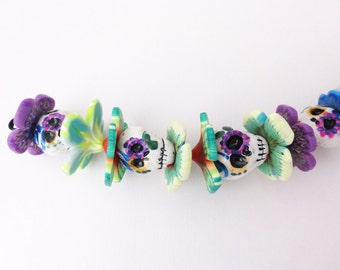 Hand painted Skulls and flowers bead set by Marie Segal