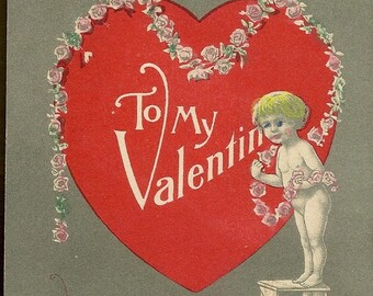Cupid Decorates a Large Red Heart for the Pink Rose Garland – Charming Vintage Valentine's Day Postcard Feb 14th 1913