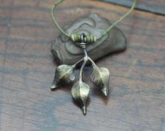 Forged Iron Leaf Necklace, a hand made three leaf pendant on an adjustable cord