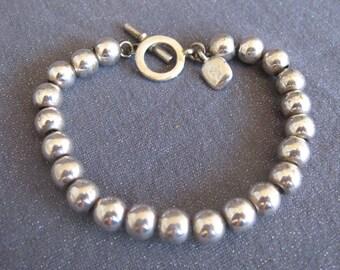 ralph lauren jewelry, ralph lauren bracelet, silver bead bracelet, designer signed bracelet, signed bracelet, beaded bracelet, minimalist