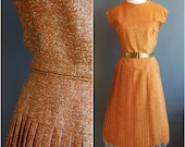 1950s medium/large orange lurex tweed dress with fitted waist and pleated skirt gold lurex dress orange tweed