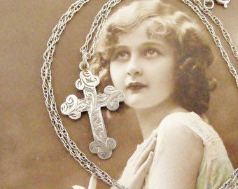 Beautiful antique cross, gothic sterling silver, hand engraved on 16 inch silver chain.