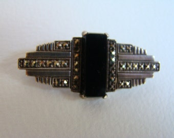 LIttle brooch in the taste of the thirties with bakelite and strass
