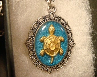 Small Turtle Necklace - Blue Glitter Background (2162)