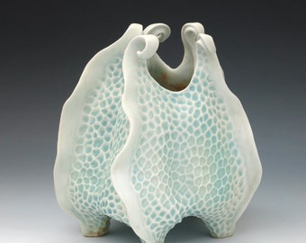 Porcelain urchin vase with curlicues in aqua and white, hand carved
