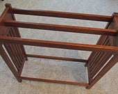 Cherry quilt rack painted white