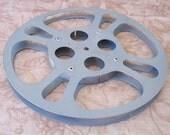 Vintage gray metal film reel.   C3-364-0