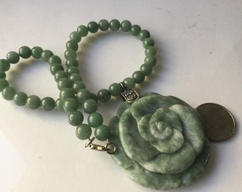 Jade beaded necklace with large carved floral pendant   VJSE