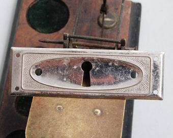 Antique metal key hole escutcheon plate.