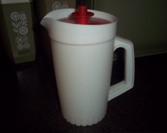 Vintage Tupperware Sheer 8 inch Pitcher Water Tea Lemonade Kool Aid Pitcher with bright red push button seal lid
