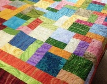A scrappy quilt of Sandscape by Northcott fabric 53 x 53