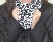 infinity scarf in soft minky leopard print. Winter scarf fashion trend. Casual chic fashion accessory.