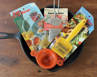 Vintage kitchen utensil assortment for brunches - egg separator, grater, egg rings, mincer - with original packaging