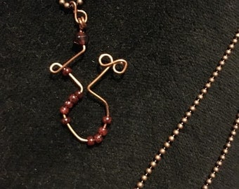Copper Goddess Body with Garnet on a Ball Chain