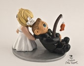 Bride dragging groom cake topper with dog