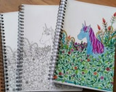 A5 notebook. Colour your own cover. Unicorn in the wild