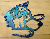 Blue wolf made of brushed aluminum, alcohol inks, wire wrapped beads and glass fusion embellishments