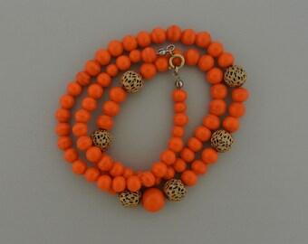 "Glass Orange Swirl Necklace with Gold Tone Filigree Beads.  22"" Long"