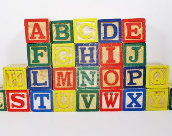 Complete set of 26 alphabet blocks with letters and line drawings
