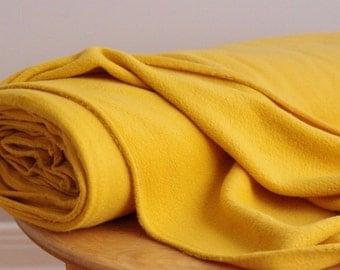 Golden yellow polar fleece fabric by the yard