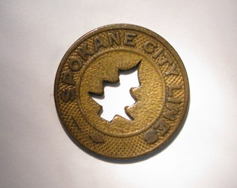 Vintage Token Spokane Wa Railway Transit Token cut out tree 'Good for one Fare' Spokane, Wa.