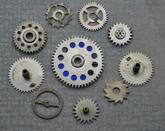 Set of 10 Vintage brass gears,wheels,cogs.