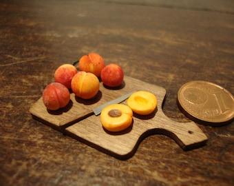 miniature dollhouse cutting board  with peaches