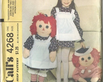 Uncut 1974 McCalls Raggedy Ann and Andy 36 inch Dolls and Clothes.  The Ann Apron Fits Girl Sizes 2 to 6