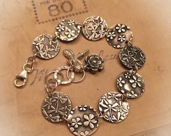 Dragonfly and flower silver disk bracelet