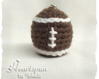 Football EOS Lip Balm Holder with clip.  Hand crocheted. Will fit eos or similar size lip balms.  Lip balm NOT included.