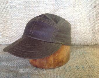 Waxed Cotton 5 panel fitted cap with center front seam. Fitted to any size. Leather or cotton sweatbands, adjustable available upon request.