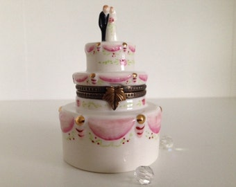 Limoges stile,three tiered wedding cake porcelain ring box.......