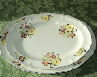 2 Vintage Ceramic Platter trays with matching retro floral design decal print on each tray with great crackled  glazed patina in Good Shape