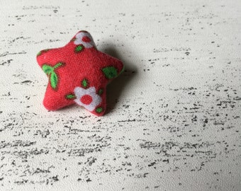 Red floral star shaped badge brooch pin back