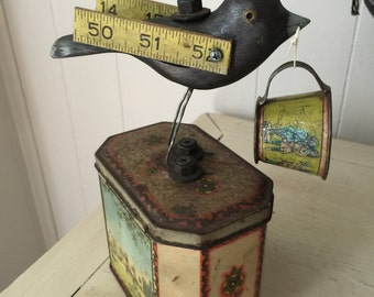 Hand carved mixed media art bird sculpture on vintage metal tin box
