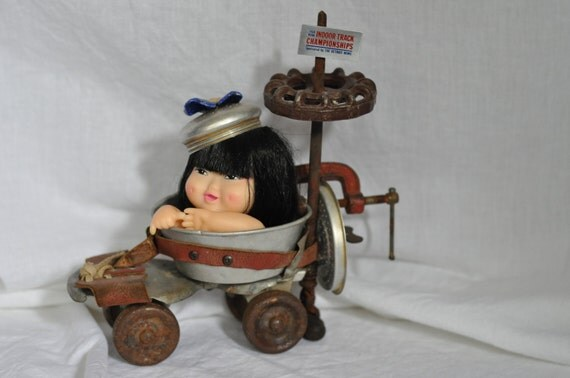 Rad Roller OOAK assemblage doll has a vintage handmade race car from found objects