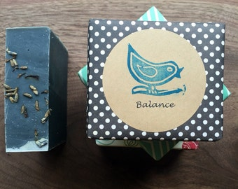 Balance hand crafted soap.  Combination skin.  Activated charcoal. Essential oils -- patchouli, lavender.  Vegan. On a Branch soap.