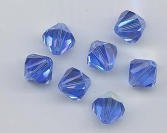 Eight  vintage Swarovski crystal beads - Art. 364/5301 - 12 mm - sapphire AB