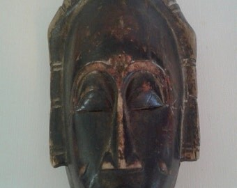 AFRICAN MASK Hand carved. VINTAGE. Beautiful piece of African Art. Mask has a peaceful and calm look. Wooden carved mask.
