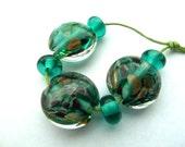 teal and goldstone lentil handmade lampwork glass beads