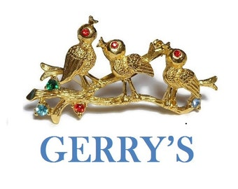 Gerry's birds brooch, gold pin with birds on a log, red rhinestone eyes, red, green and blue rhinestone flowers, figural floral brooch