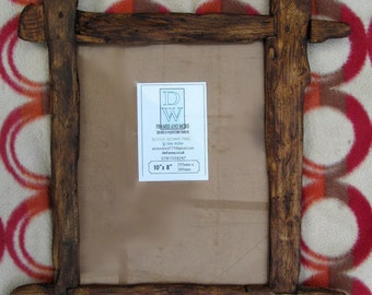 """Rustic,cross jointed frame in locally sourced,recycled pine in medium oak/antique pine beeswax finish.To fit 10""""x8"""""""
