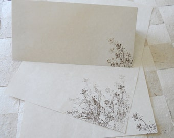 Large parchment paper stationery set, writing paper hand cut and stamped with wild flowers in walnut colored ink. Set of 30.