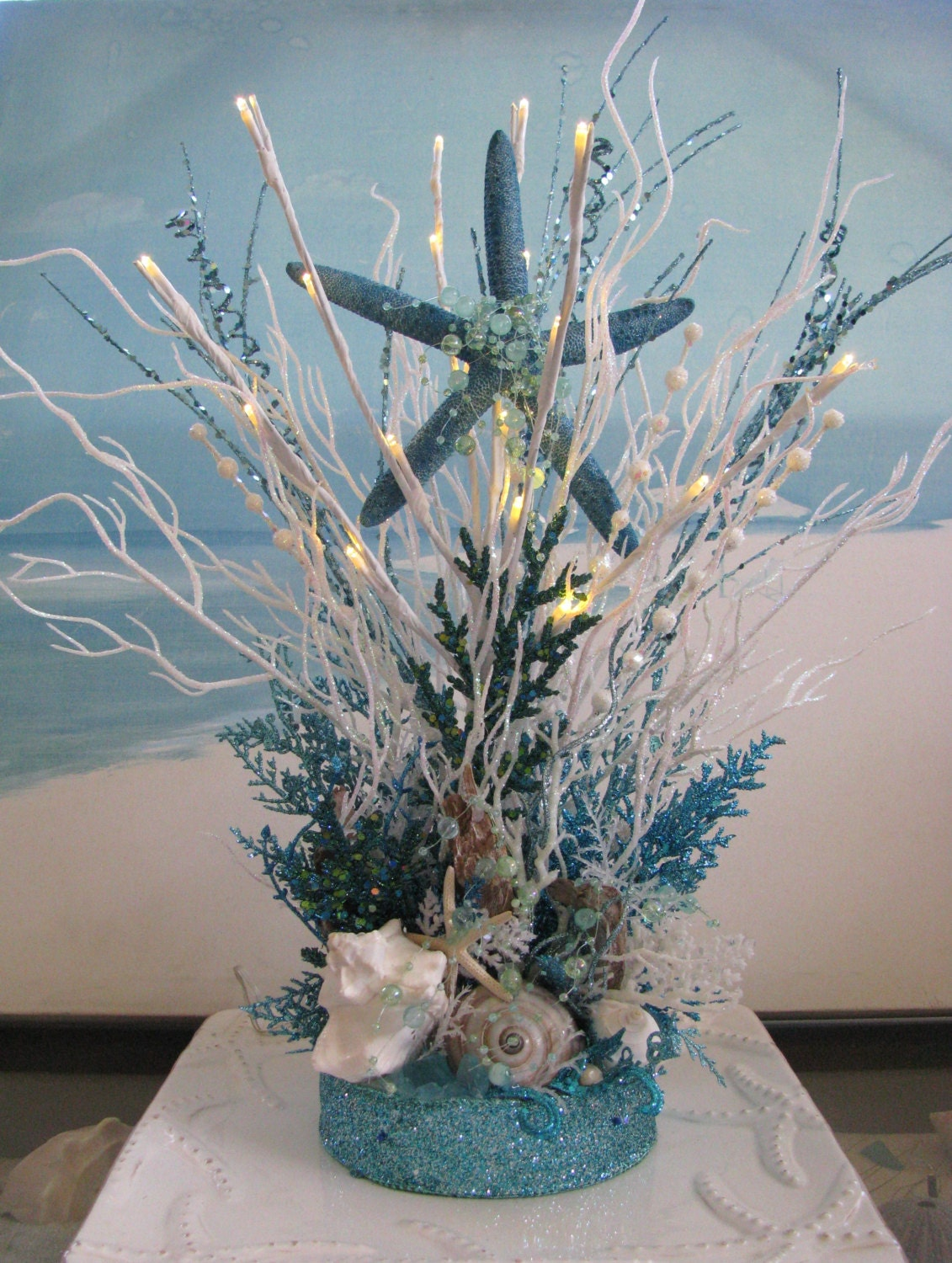 White and blue coral beach wedding centerpiece seashell