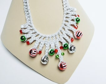 Crocheted statement necklace in a silvery grey thread and red, green and silver beads.