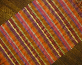 Handwoven Nicaraguan Rag Rug in Amber, Orange, Fucsia, Maroon, and Purple